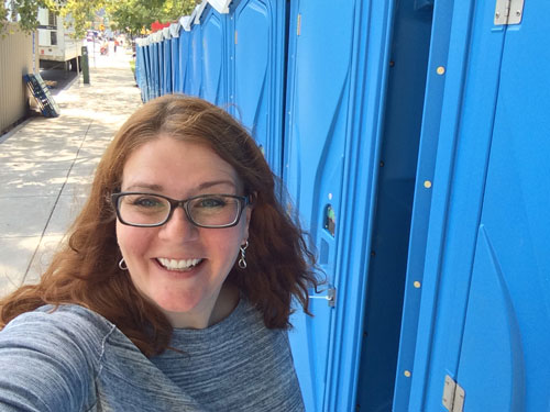 Selfie with porta-potties.