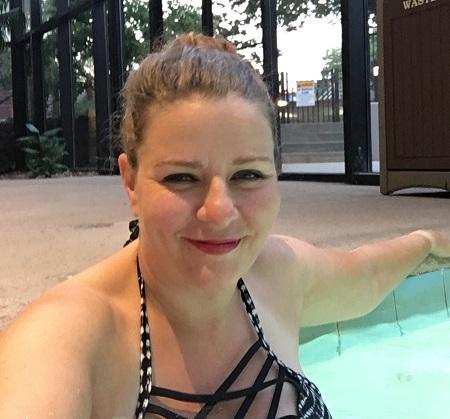 kim in a hot tub