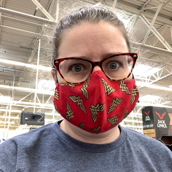 Kim in a wonder woman mask
