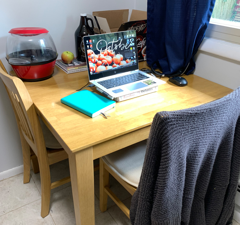 kitchen table with a laptop on it