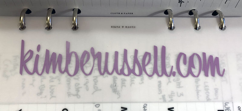 the kimberussell.com logo, printed in vinyl and stuck into my planner