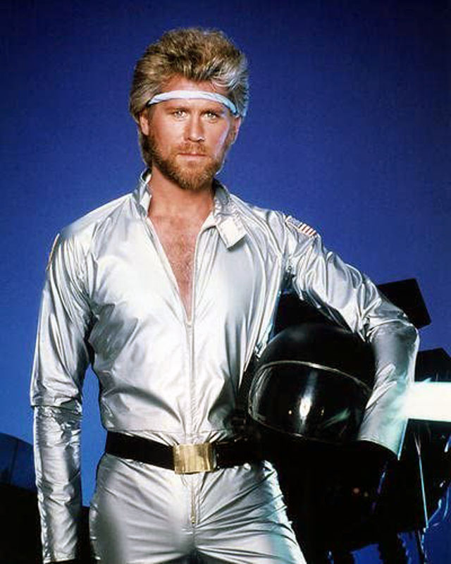 Barry Bostwick in Megaforce. He's in a sliver lame jumpsuit.