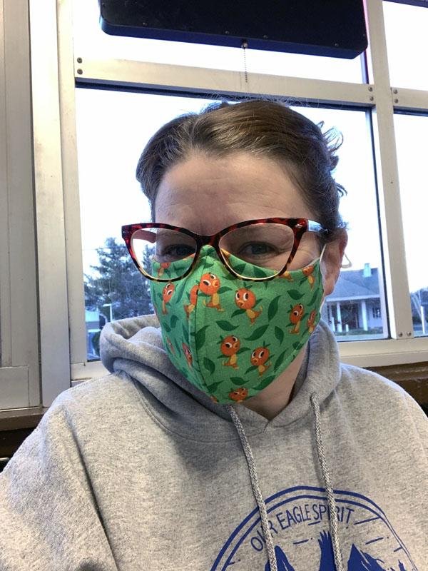 selfie with a Disney Orange Bird face mask.