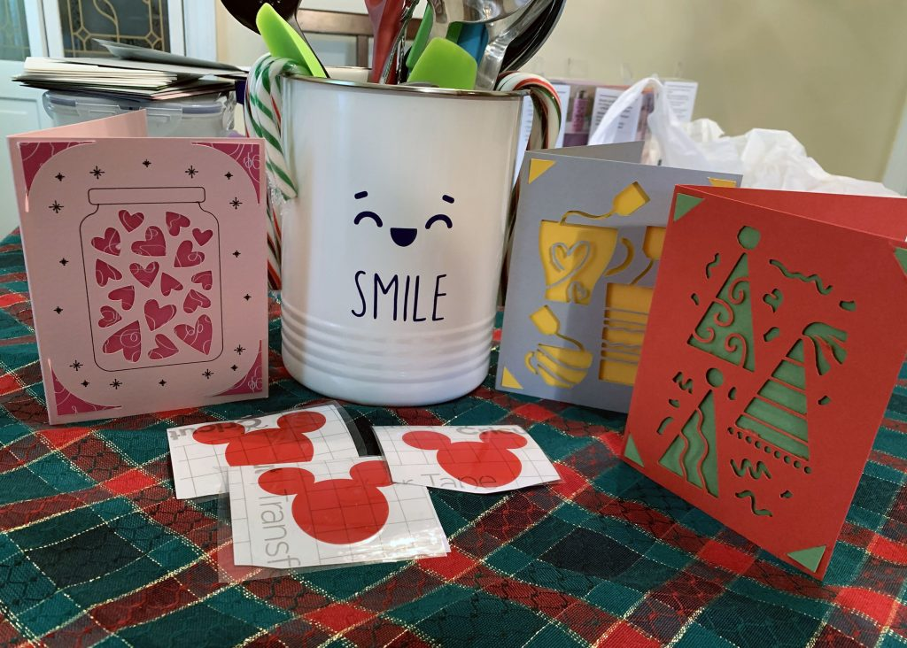 photo of 3 greeting cards, 3 mickey stickers, and a utensil crock with a weird smile on it
