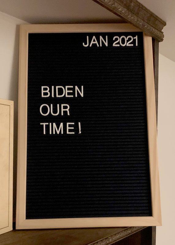 letterboard that says 'biden our time'