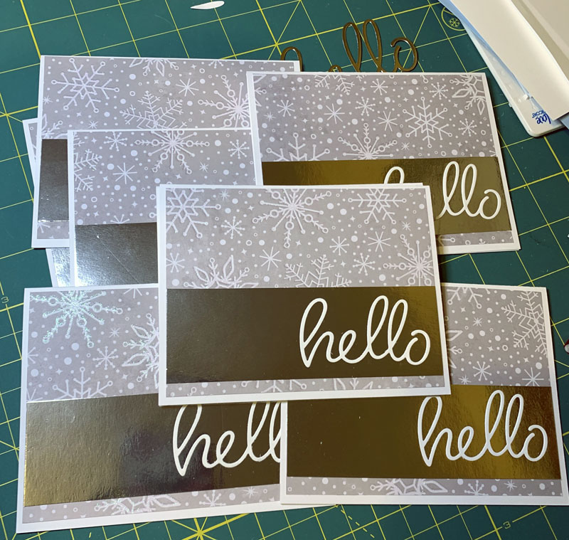 a pile of sparkly cards that say hello