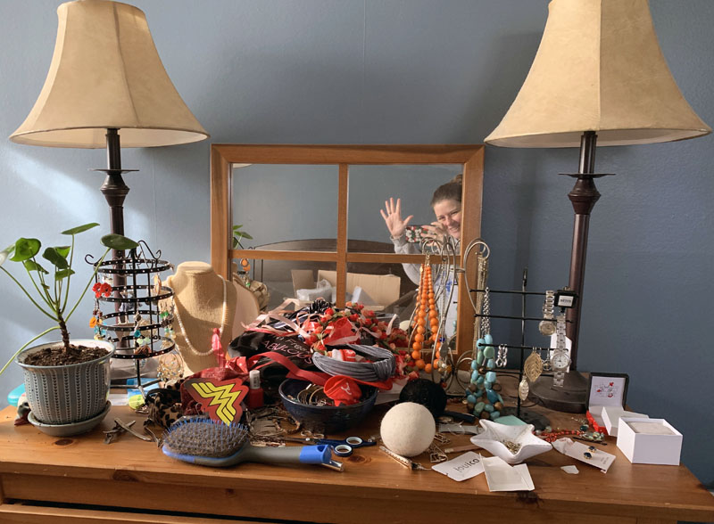 a giant pile of clutter and shit all over my dresser top. you can't even see the jewelry.