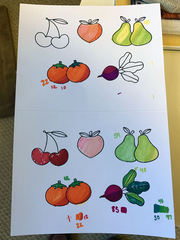 a sheet of partially colored vegetables