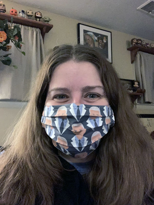 kim wearing a fabric face mask with dr fauci print