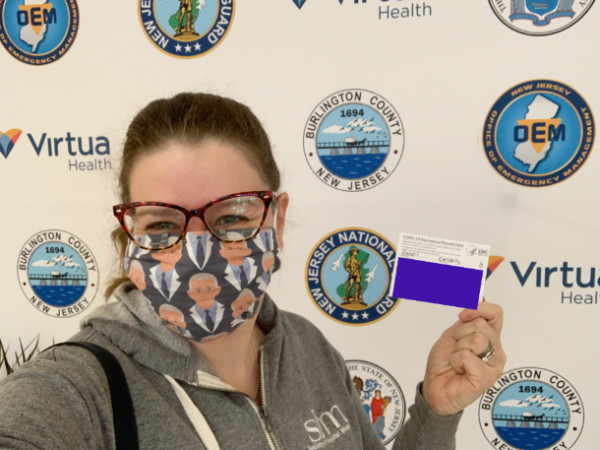 stupid Kim cheesing it up at the vaccine center selfie station.