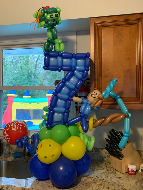 a Minecraft-themed balloon sculpture in the shape of the number 7