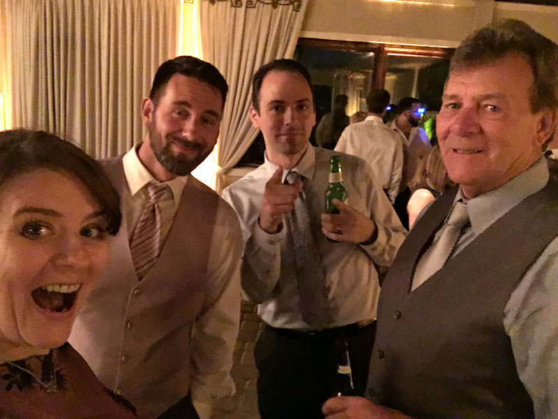 me, my cousin, my brother, my dad at a family wedding