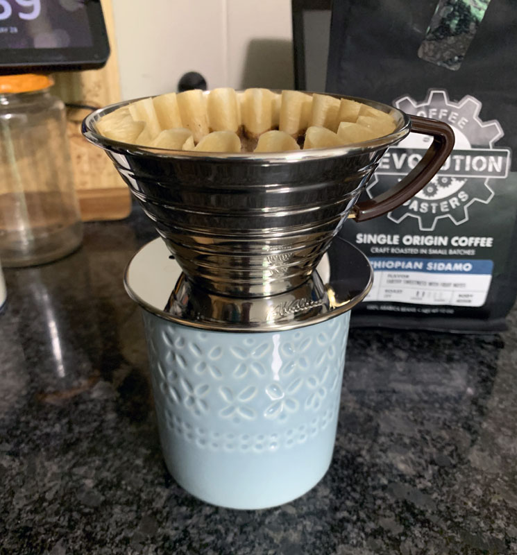 a pour-over contraption on top of a coffee cup