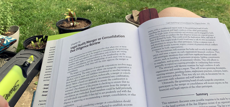 photo of the Association Law Handbook, being read.