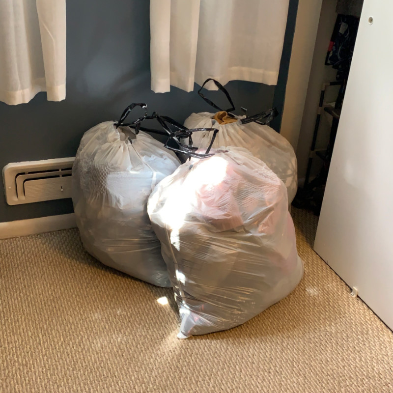 a photo of three garbage bags filled with clothing. A scintillating photo, sure to draw people to my blog by the tens.
