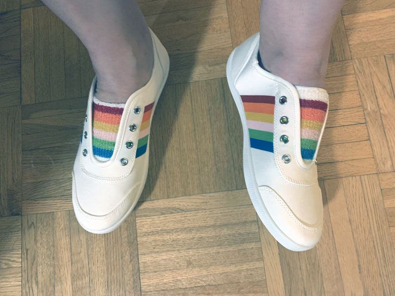 white sneakers and rainbow trim