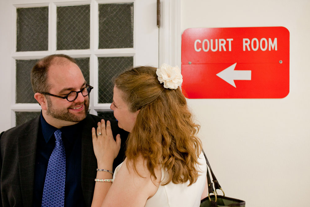 WM and I on our wedding day, nine years ago. Behind us is a sign that says Court Room