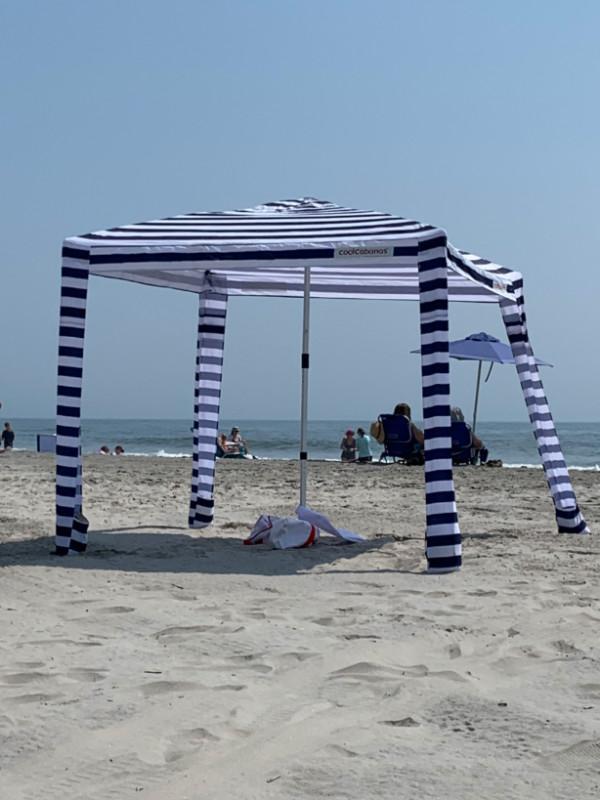 a weird umbrella/cabana structure on the beach.