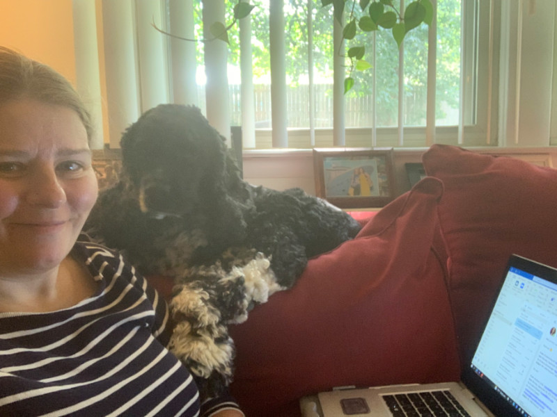 kim and dog and laptop on the sofa